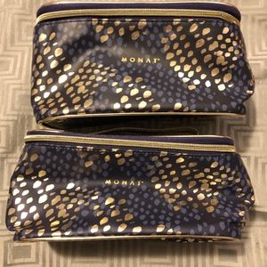 2 Monet gold and navy blue cosmetic bags